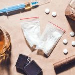 How are drugs addictive, and why is dependency different?